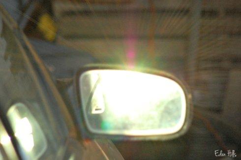 sun in car mirror