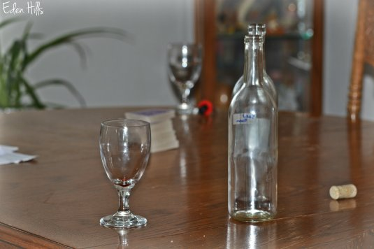 empty wine bottles and glasses