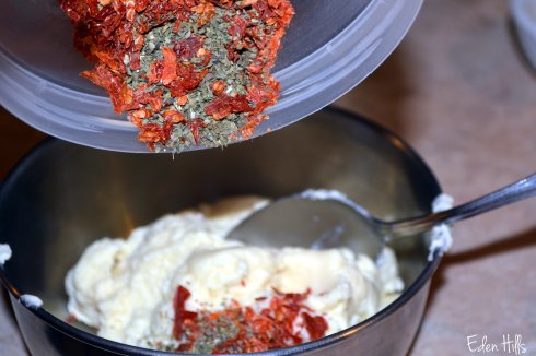 adding herbs to cheese spread