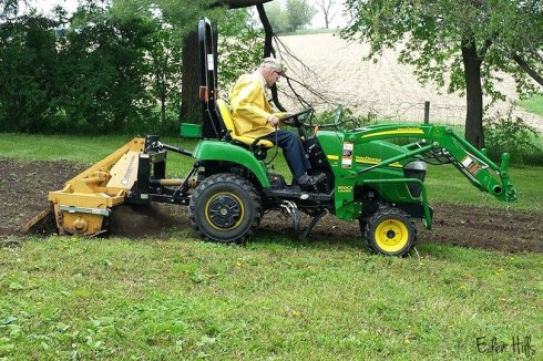 tractor tilling w